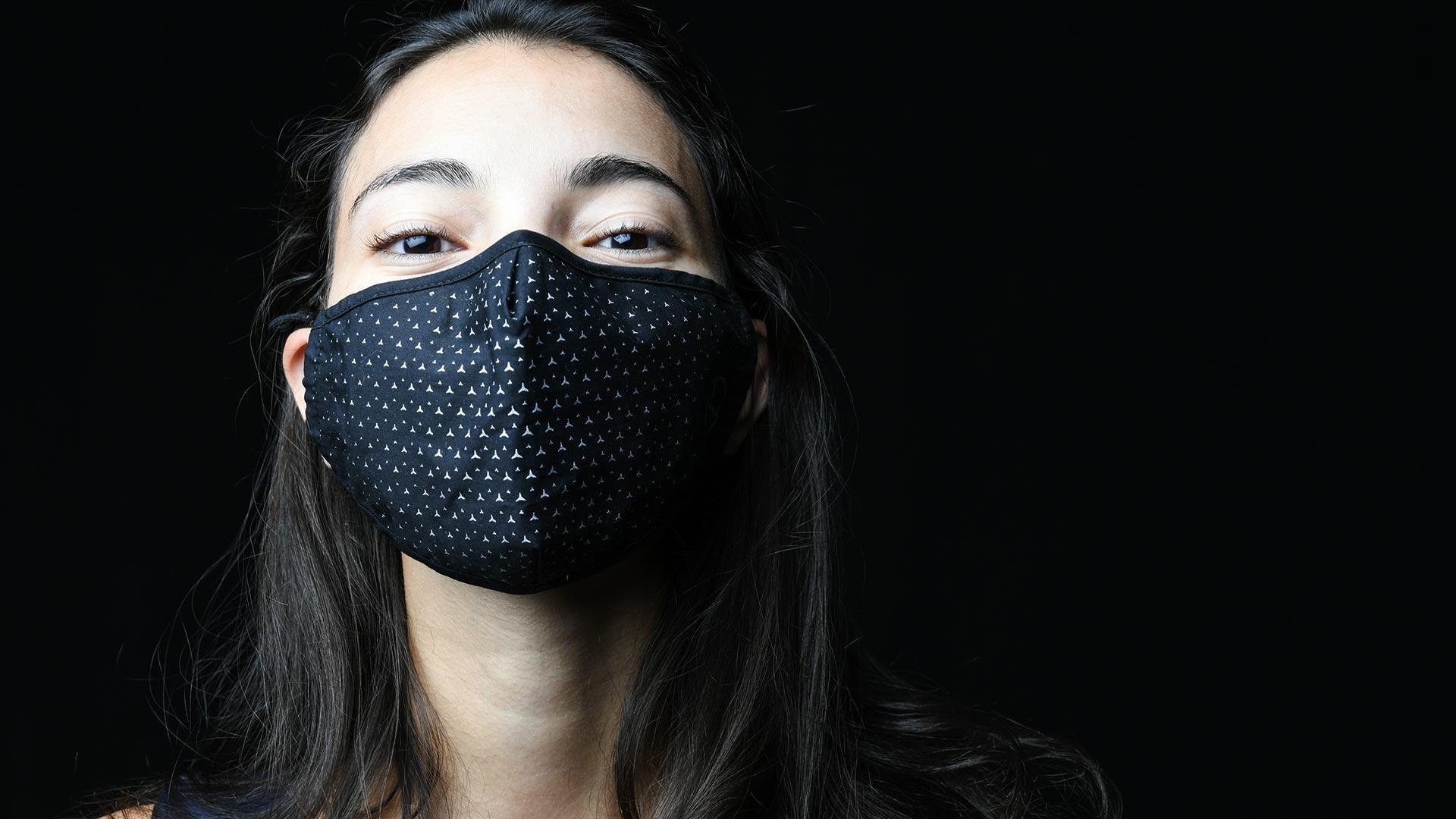 Les Trophées de l'Environnement Photo illustrative femme masquée cheveux longs