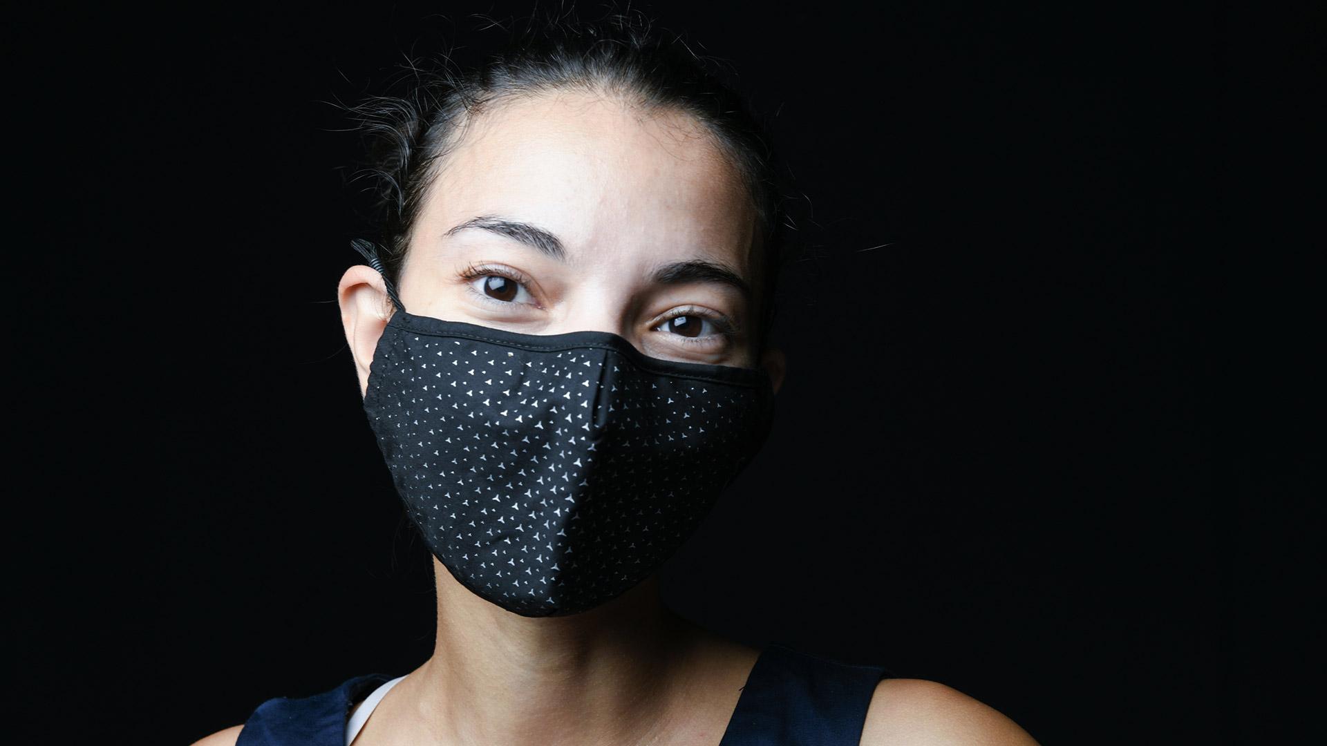 Les Trophées de l'Environnement Photo illustrative femme masquée